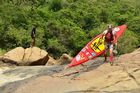 Dusi 2015 - Jon Ivins portaging over of Tombi Rapid on day 2